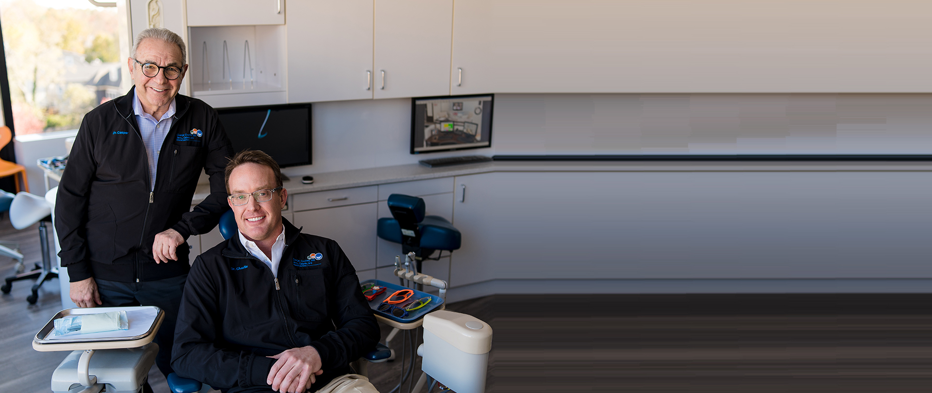 Dr. Charlie Coulter and Dr. Jerry Casper pose in the office of their pediatric dentistry practice in Washington, DC.